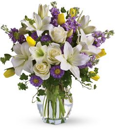 "Send this feminine bouquet of favorite spring flowers for Mother's Day or to brighten someone's home with the playful beauty of nature."" This white, lavender and yellow bouquet includes white asiatic lilies, Deco Floral, Arte Floral, Most Beautiful Flowers, Pretty Flowers, Fresh Flowers, Spring Flowers, Mini Orquideas, Cemetery Flowers, Wedding Ceremony Flowers"