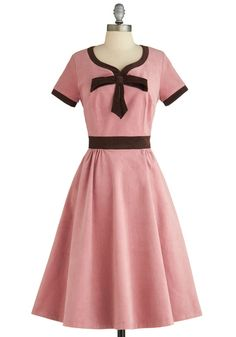 Cute pink 50s dress. I like the detail of the brown, but wish it was charcoal gray or white instead.