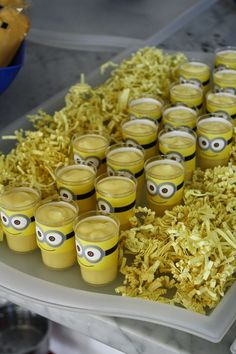 Banana pudding shooters for a dessert treat and decor for a minion party. Click or visit fabeveryday.com for more photos and details from this Despicable Me Minions themed birthday party.