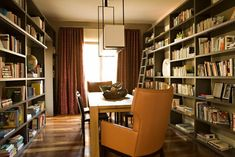 Turn your dining room into a library. Fill the walls with floor-to-ceiling bookshelves and amp up the cushy reading room feel with an upholstered armchair at the head of the table. Want to really go the distance? Bring in a library ladder to reach the highest shelves.