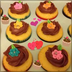 Cupcakes I made with my Granddaughter today. Yellow cake, chocolate frosting, and fondant flowers