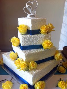White, Blue And Yellow Wedding Cake on Cake Central