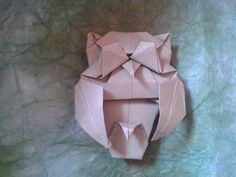 Origami Owl folded by me Design by John Richardson  Diagrama here http://how-to-origami.com/horned-owl-origami.html