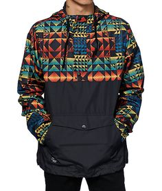 Stand out with a vibrant multi color geo print upper with a half zip snap button closure and a drawcord adjustable hem for a perfect fit.