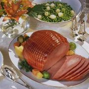 Hams are available in an array of styles: bone-in or boneless; canned or vacuum sealed; smoked or cured; fully cooked or ready-to-cook. A precooked boneless ham can be served cold, but if you choose to warm it, the ham must be heated all the way through. If you want to add a glaze or sauce, wait until the meat is in its last hour of cooking.