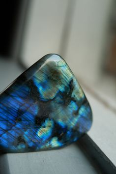Labradorite! A dull grey stone that comes to life when you tilt it to get the right angle! Beautiful!