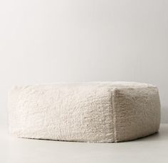 RH TEEN's Berlin Lounge Sherpa Ottoman:The next-generation bean bag. Our collection& body-conforming foam-and-bead insert ensures classic sink-in comfort, while the raised back and arm rests add an element of support to its relaxed silhouette.
