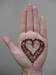 very nice tattoo in the shape of a heart which was painted with henna ...