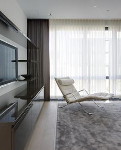 Contemporary room with floor to ceiling sheers paired with drapes.