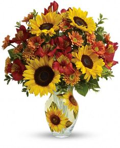 Teleflora's Simply Sunny Bouquet of sunflowers and fall flowers in a sunflower vase