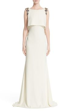Free shipping and returns on Badgley Mischka Embellished Shoulder Popover Bodice Gown at Nordstrom.com. Colorful jeweled appliqués drape the shoulders and spark the elegant attitude of a striking mermaid gown with beautifully weighted drape. A popover-style bodice flutters down the deeply V-ed back to enhance the gracefully fluid lines.