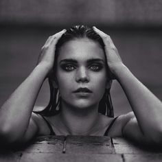 Photoshoot, photography, model, black and white, pool, poolside, eyebrows, slick, wet, wet hair, moody