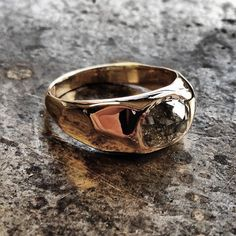 The Facet ring was commissioned as an engagement ring. The sharply carved form evokes naturally occurring geometry and lends the ring monumental qualities. The diamond set in the wax model and cast to be encapsulated by molten gold.  Rose cut natural grey diamond, 14K gold. Black Sheep & Prodigal Sons