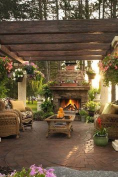 Gorgeous pergola and outdoor fireplace form a sublime outdoor living space