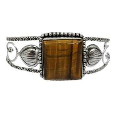"""Iba Handcrafted Silver Tone Tiger Eye Stone Adjustable Cuff Bracelet Fashion Bollywood Party Wear Jewelry IBA. $15.99. Silver Tone Cuff. SIZE - Width from top 1""""inches(Adjustable), Stone length:1.1"""" x 1""""inches; COLOR - Silver Tone;. SALE FOR - 1 Cuff Bracelet; MATERIAL - Alloy;"""