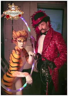 Another shot of our lion tamer and tiger at the circus-themed party at Prohibition in Houston, TX.  body paint, custom costuming, sequins, Entertainment provided by J&D Entertainment www.jdentertain.com