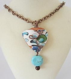 Beach Pottery Turquoise Pendant: I hand collect beach pottery and sea glass from Greece and used this lovely natural pottery piece, along with the turquoise ceramic bead and wire wrapped