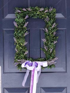 Lovely Lavender. A rectangular wreath with a big lavender bow is neither too modern nor too traditional. The wreath is made of dried lavender sprigs, boxwood, cedar, and eucalyptus.