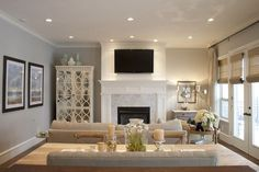 White mantle, white paneling behind tv, grey/white tile surround
