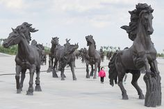 Horse statues built as a tribute to Genghis Khan whose unmarked tomb is believed to be nearby in the city of Ordos, Inner Mongolia, China. Horse Sculpture, Animal Sculptures, Ghost City, Genghis Khan, Friesian Horse, Thoroughbred, Equine Art, Mongolia, Horse Art