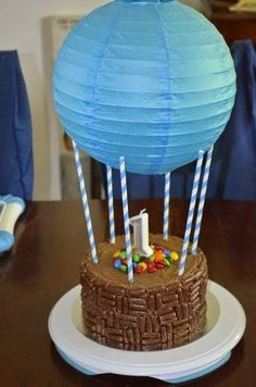 Hot Air Balloon 1st Birthday Cake - love this for an up, up, and away 1st birthday party.
