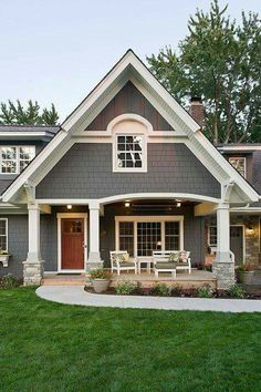 exterior paint colour plus stone is same as current dark grey siding Exterior Traditional with arch window front porch Exterior Gray Paint, Exterior Paint Colors For House, Paint Colors For Home, Exterior Design, Grey Paint, Grey Homes Exterior, Wall Exterior, Exterior Remodel, Siding Colors For Houses