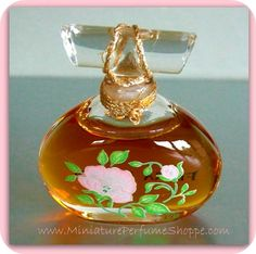 """Our mini of the day. Vintage (1980) mini perfume bottle of  FLORA DANICA by Swank. Measures only 1.75"""" high. Reverse side reveals the beautiful Royal Copenhagen pink damask rose motif."""