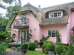 Perfectly manicured thatched cottage