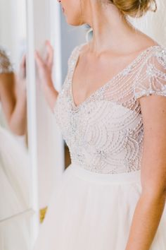 beaded two piece gown - http://ruffledblog.com/drool-worthy-wedding-gowns-we-cant-stop-looking-at photo Redfield Photography