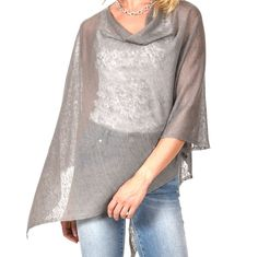 Linen Poncho This 100% linen poncho / dress topper is THE SOLUTION to so many of our spring and summertime wardrobe needs. It is slightly transparent and covers the upper arm area without over heating. Hands free and nice to drape. Whether worn casually or for an occasion...IT IS PERFECT! 100% (almost) wrinkle free linen Made in Italy