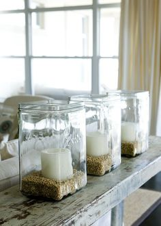 mason jar with sand and candle... candle jars with sand instead of lentils though!!... these can be made from any type of jars, seeds/rocks, and candle...any color... candle idea for table