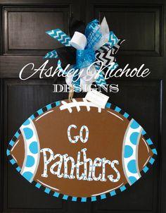 SHIPS NOW!! Carolina Panthers Inspired Football Door Hanger, Door Decoration,  Fall Wreath, Wooden Football by DesignsAshleyNichole on Etsy https://www.etsy.com/listing/241678511/ships-now-carolina-panthers-inspired