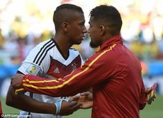 Family affair: Germany's Jerome Boateng (left) embraces his brother Kevin-Prince Boateng b...