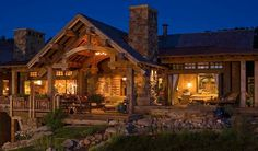 Amazing smaller log home, but with great living spaces all opening up to large covered porches with Nana Wall doors (the doors that open from casing to casing) off of the living area and master bedroom.