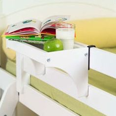 Cool wooden clip-on tray for bunkbeds. Outdated link...Not at Wayfair anymore...find it here: http://www.sweetretreatkids.com/maxtrix-kids-bedside-tray-white.html#.Uq6O6Sj0itg