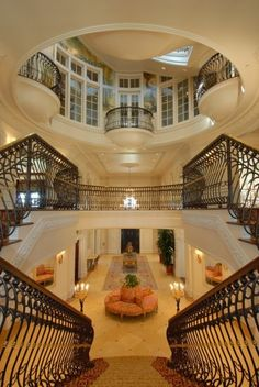 I enjoy the idea of a really extravagant entry way to a home.