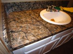 Faux granite counter tops using paint. Will be doing this in the kitchen, FOR SURE.