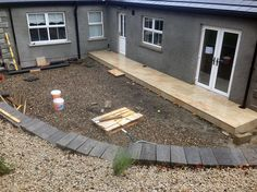 Image of private garden by Spring Landscapes during construction - our Emperor Porcelain paving in Limerick just starting to be laid.