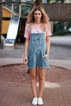 How to wear pastel pink: street style inspiration and outfit ideas from @stylecaster | 'Style By Marie' blogger in pink tee, denim shortalls, white sneakers
