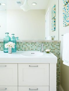Bathing, showering, grooming: With all those daily to-dos, who wants to fight bathroom clutter? http://www.bhg.com/bathroom/storage/storage-solutions/declutter-your-bathroom/?socsrc=bhgpin021015undersinkstorage&page=2