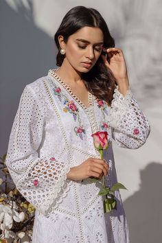A quintessential Farida Hasan cotton eye-let patchwork shirt with floral embroidery on neckline and sleeves. Comes with a cotton slip. Kurti Sleeves Design, Kurta Neck Design, Sleeves Designs For Dresses, Dress Neck Designs, Pakistani Fashion Casual, Pakistani Dresses Casual, Pakistani Dress Design, Pakistani Clothing, Indian Dresses
