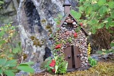 This STONE FAIRY HOUSE / CHURCH with STAINED GLASS WINDOW will open wide its WORKING DOORS to all of the fairies and Pixies in your neighborhood. Perfect centerpiece of any Fairy Garden. Made of real stone, wood, moss, stained glass and pixie sprinkles. It is suitable for indoor
