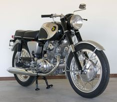 Spotless 1964 Honda Super Hawk 305 CB77. When possible, a totally restored, cafe racer style 305 is on my list.