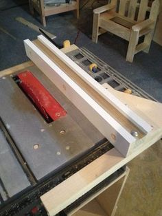 new table saw rip fence. (and while you're at it, see the little wooden chair in the background?)