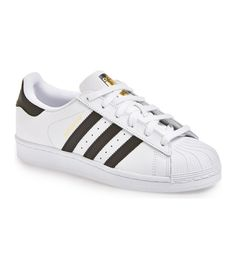 4dde709a9ac9 superstar sneaker by adidas. First introduced in this iconic basketball shoe  (now updated with sleeked-down shell toe) merges classic brandi.