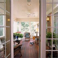 LOVE this floor on screened porch.  Wonder what it would look like to stain my boards this dark?