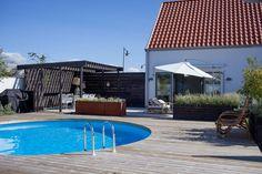 11-snitsig-tradgard-och-landskap-tradgardsdesign-helt-enkelt-pool-modern