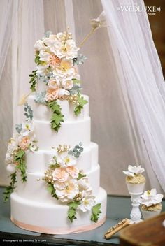 Seven tiered white floral decorated cake