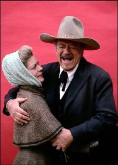 John Wayne gets a rise out of Lauren Bacall on the set of The Shootist. He had the GREATEST laugh!!