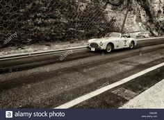 Download this stock image: GOLA DEL FURLO, ITALY - MAY 19: CISITALIA 202 CABRIOLET 1948 on an old racing car in rally Mille Miglia 2017 the famous italian historical race (1927- - KB5J66 from Alamy's library of millions of high resolution stock photos, illustrations and vectors.
